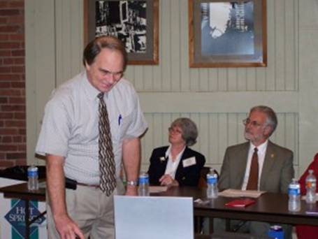 Bob Driggers presents Power Point as Peggy Maruthur and Gene Shelby look on